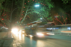 Vehicles and light, trees in the modern city, in the night Royalty Free Stock Photos