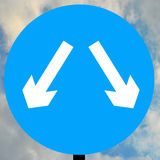 Vehicles may pass either side to reach same destination. Road traffic sign Royalty Free Stock Photos