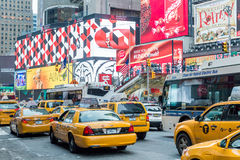 Vehicles move along Broadway in Times Square in New York City Stock Photos