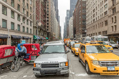 Vehicles move along 5th Avenue in New York City Stock Photos