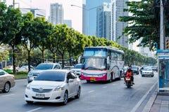 Vehicles move along Thanon Ratchadaphisek near Esplanade Ratchadapisek Shopping mall Stock Photos