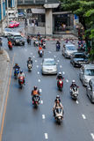 Vehicles move along Thanon Silom near Lumpini Park Royalty Free Stock Images