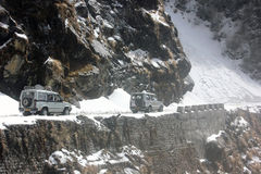 Vehicles negotiating a landslide in eastern Sikkim Royalty Free Stock Image