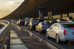 Vehicles outside Beijing International airport during evening. stock photography