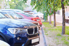 Vehicles parked near the road Royalty Free Stock Photo