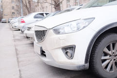 Vehicles parked in parking lot Stock Photo