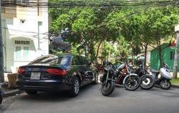Vehicles parking on street in Binh Thanh, Saigon, Vietnam.  Royalty Free Stock Photo
