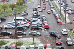 Vehicles parking on street and strong raing with snow Stock Images