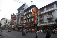 Vehicles pass along Yaowarat Road in Chinatown Stock Photography