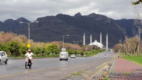 Vehicles passing by Faisal Mosque Islamabad Royalty Free Stock Images