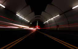 Vehicles Passing Fast in a Tunnel Stock Photo