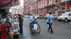 Vehicles and people on street in Kolkata, India Royalty Free Stock Photo