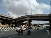 peoples and vehicles are running under over bridge At chennai city,india stock image
