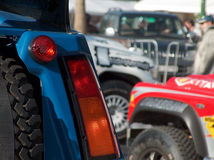 Vehicles at road rally. Partial view of vehicles at a road rally Royalty Free Stock Photos