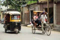 Vehicles run on street in Amritsar, India.  Royalty Free Stock Image