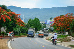 Vehicles run on street in Lai Chau, Vietnam.  Royalty Free Stock Photography