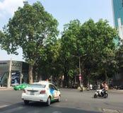 Vehicles run on street in Saigon, Vietnam Stock Images