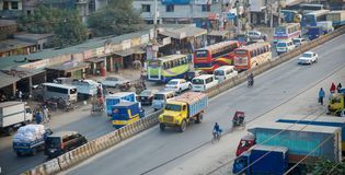 A busy highway in Dhaka city. Vehicles running in a highway around the Dhaka city unique editorial photo royalty free stock photography