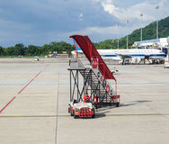 Vehicles on runway at the airport in Penang, Malaysia.  Royalty Free Stock Photography