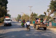 Vehicles on rural road in Inle, Myanmar Stock Image