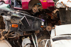 Vehicles rust on scrapyard. Scraped vehicles are waiting to be recycled Royalty Free Stock Images