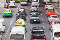 Vehicles and Traffic Jam near the Victory monument. Bangkok, Thailand - July 24, 2015: Vehicles and Traffic Jam near the Victory monument in Bangkok, Thailand Royalty Free Stock Photo
