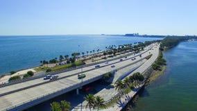 Vehicles travel along the Rickenbacker Causeway in Miami Royalty Free Stock Photos