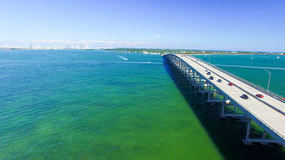 Vehicles travel along the Rickenbacker Causeway in Miami Stock Photos