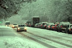 Vehicles traveling on snowy roads Royalty Free Stock Image