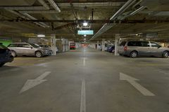 Vehicles in underground parkade Royalty Free Stock Photography