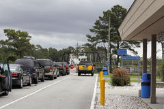 Vehicles Waiting to Board Southport Ferry. Southport, NC, USA - September 29, 2016: People in vehicles waiting to drive onto the Southport Ferry in the day stock photography