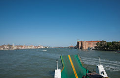 Vehicular ferry on Venice harbor. Vehicular ferry loading ramp  foreground to Venice harbor Royalty Free Stock Photo
