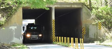 A vehicular tunnel shown with traffic Royalty Free Stock Image