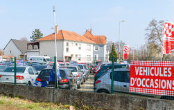 Vehicules d`Occasion translating as Used Cars garage Royalty Free Stock Photos