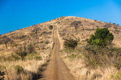 Veicolo della collina 4x4 della strada non asfaltata   Fotografia Stock