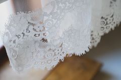 Veil bride hanging in the hotel room. Morning bride. Wedding day stock photography