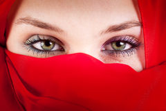 Veil woman with beautiful sexy eyes. Red veil woman with beautiful sexy eyes Stock Photo