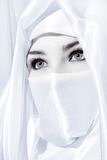 Veiled. Head shot of woman in face veil royalty free stock photo