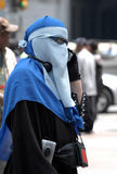 Veiled city woman. Veiled woman in the city stock images