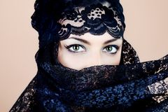 Veiled face. Shot of a beautiful asian woman with black veil on face, traditional arabian costume Stock Images