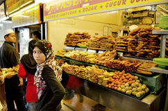 Veiled girl at snack stand in penang malaysia Royalty Free Stock Photography