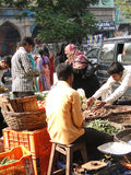 Veiled muslim women shop for food Stock Images