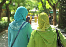 Veiled Muslim women. Two veiled muslim women walking down the street stock photography