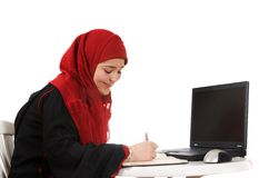 Veiled in the office. Young woman in an office, wearing a veil Royalty Free Stock Photos