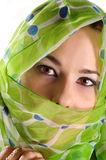 Veiled woman with intense look stock images