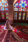 Veiled woman in mosque. Shiraz, mosque nasir al-mulk, Iran Royalty Free Stock Image