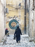 Veiled woman in old town street of aleppo syria Royalty Free Stock Photo
