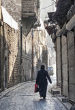 Veiled woman on old town street in aleppo syria Royalty Free Stock Photography