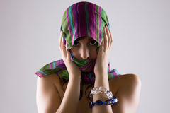 Veiled Woman In Shadows. Sensual Cute Woman Covering Her Face With A Colorful Veil Royalty Free Stock Photo