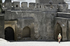 Veiled woman walks across Kasbar courtyard Stock Image